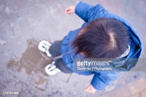 Little boy looking at his reflection. : Stock Photo