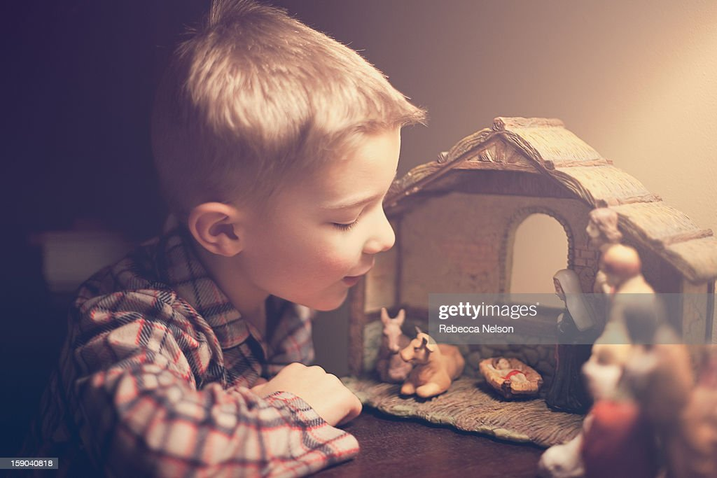 Little boy looking at nativity scene