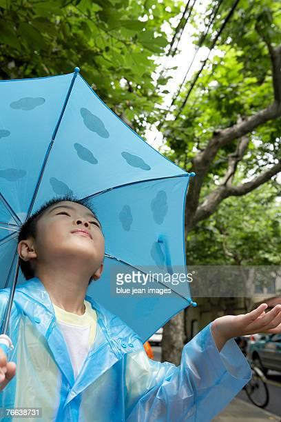 A little boy looking for rain.
