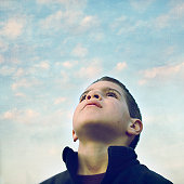 Little boy looking up in sky