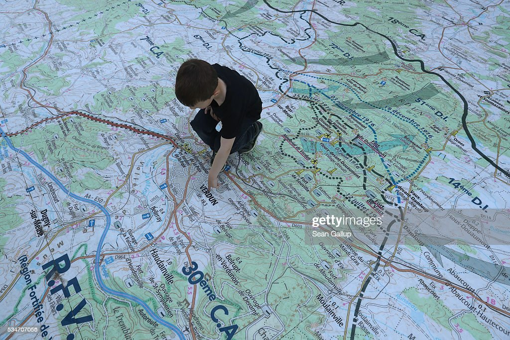 A little boy looks at a giant map showing the 1916 World War I front lines between French and German armies around Verdun in the town center on May 27, 2016 in Verdun, France. The governments of France and Germany will commemorate the 100th anniversary of the World War I Battle of Verdun with ceremonies this coming Sunday. Approximately 300,000 soldiers lost their lives in the 10-month campaign that was among the most grueling battles of World War I.