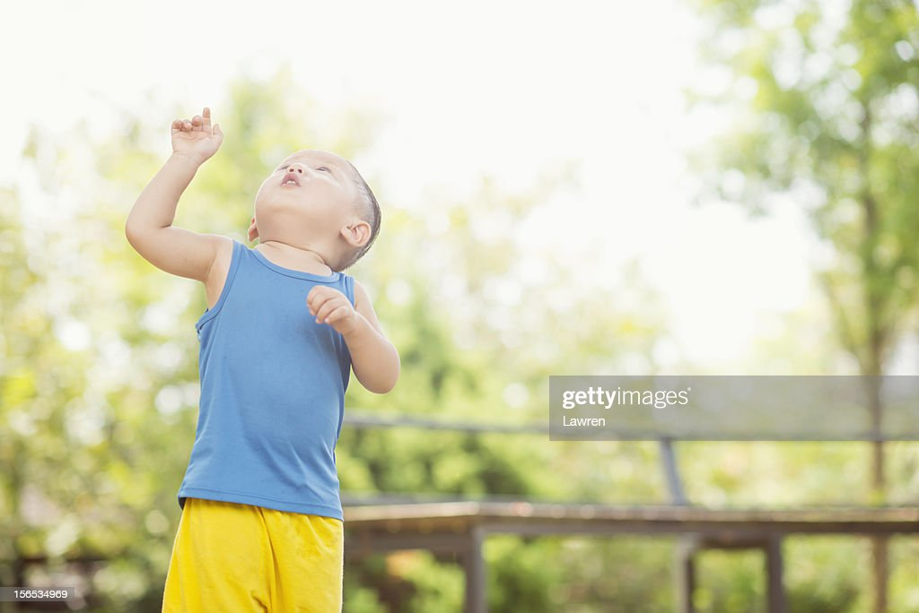 Little boy looks upward : Stock Photo