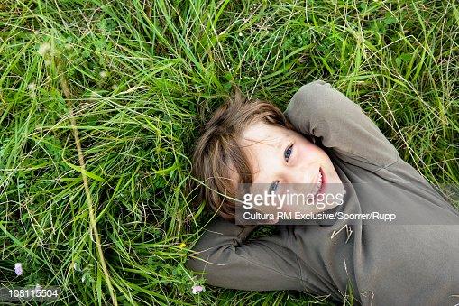 Little boy lying in grass : Stock Photo