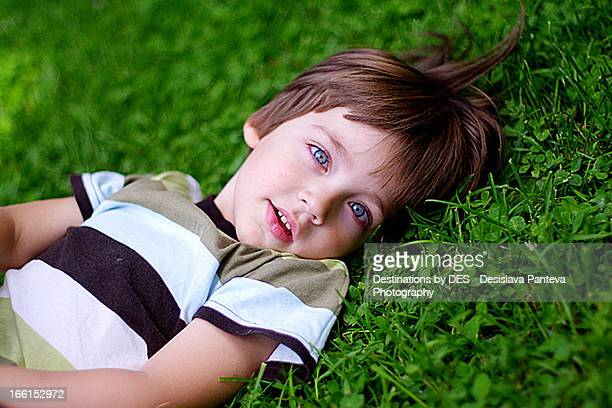 boys with brown hair and blue eyes stock photos and