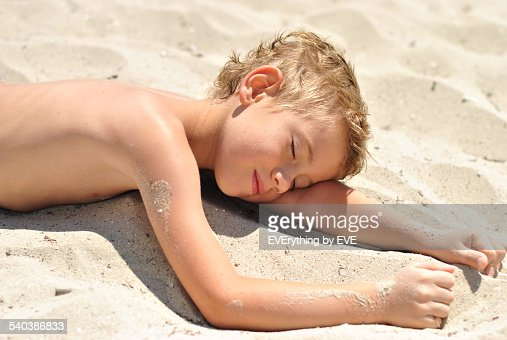 Little Boy Lying On The Sand On The Beach Of Sea Stock ...