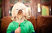 Little boy making cakes