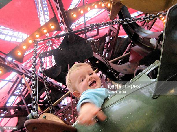 Little boy on airplane in merry-go-round