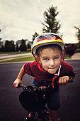 Little boy on bike with helmet
