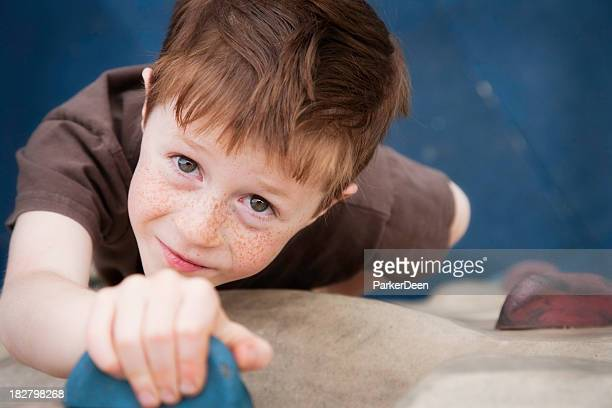 Little Boy on Climbing Wall at Playground
