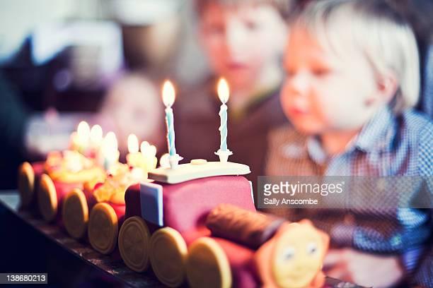Little boy on his birthday with birthday cake
