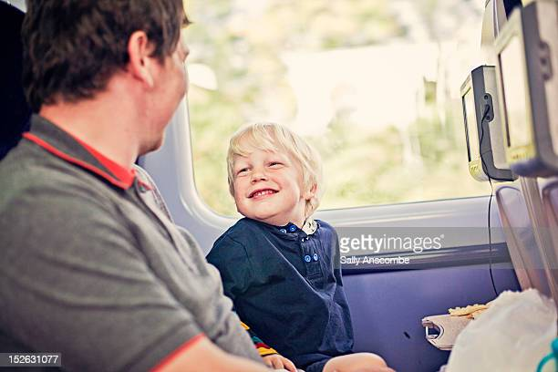 Little boy on train with his Father