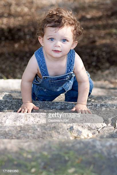 Little Boy Outdoors in Blue Denim Overalls