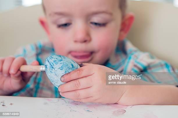 Little Boy Painting Easter Eggs