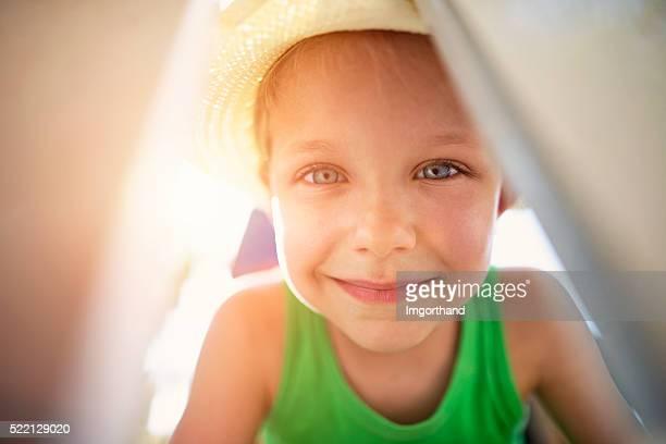 Little boy peeking into tent.