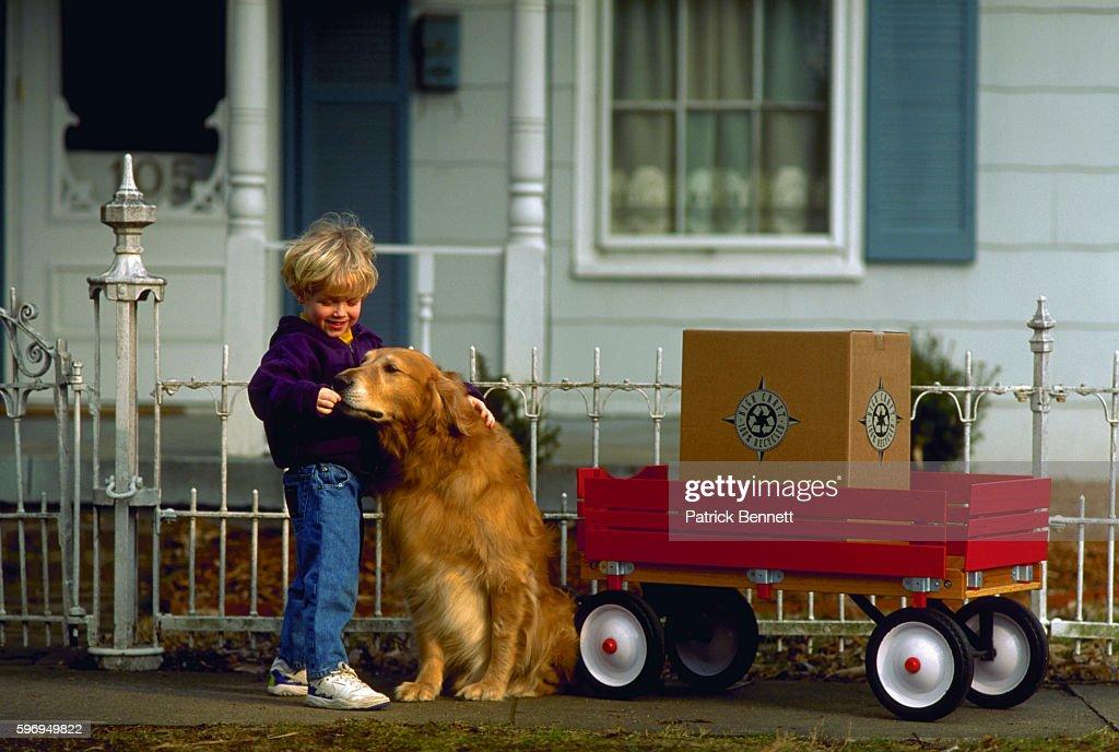 Little Boy Petting His Dog