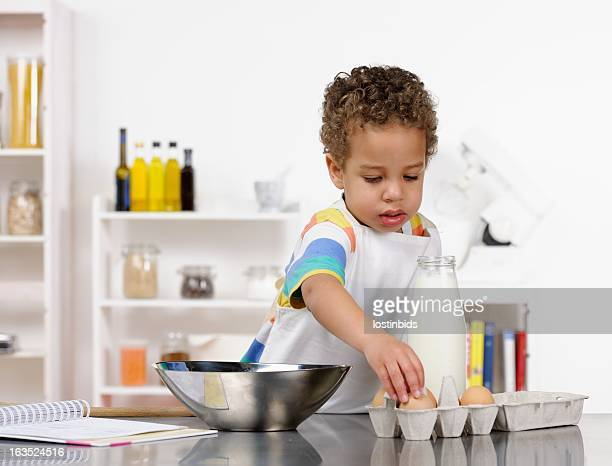 Little Boy Picking Out Egg From Box