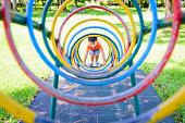 Little boy playing a game circled climb.