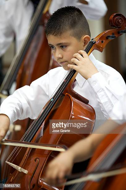 Little boy playing a violin at a classical Music concert