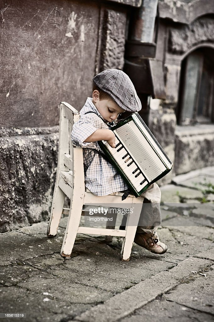 Little boy playing accordion