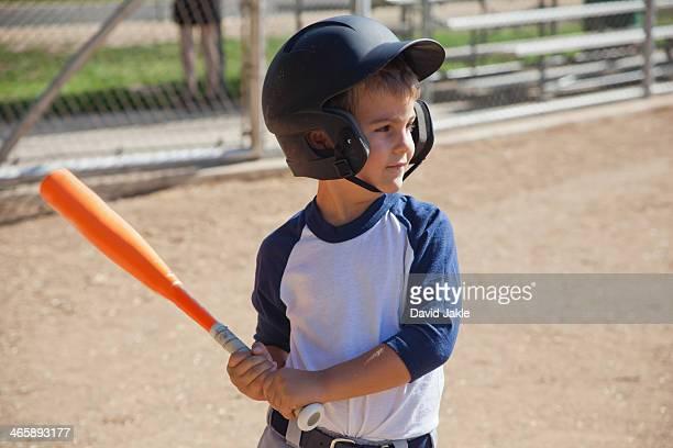 Little boy playing baseball
