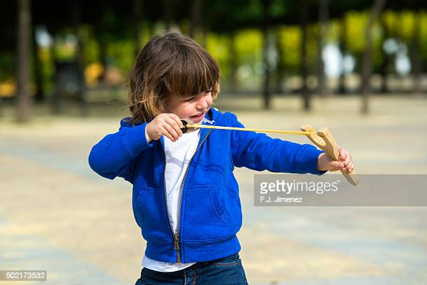 Little boy playing catapult