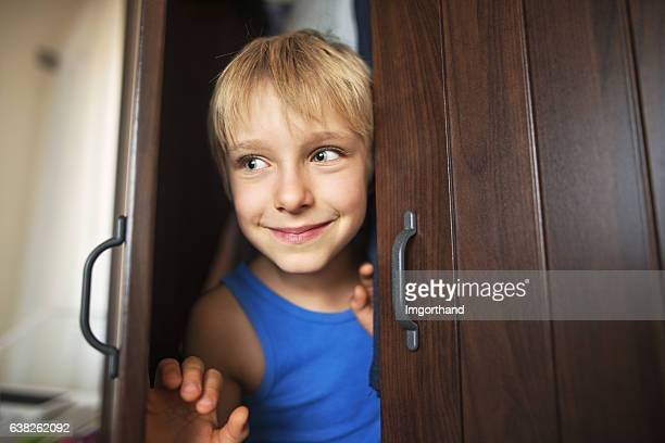 Little boy playing 鬼ごっこ
