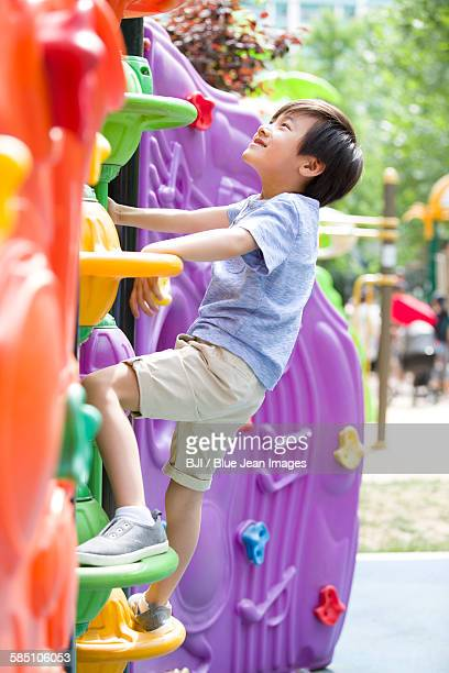 Little boy playing in amusement park