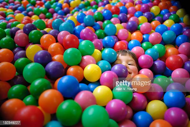 Little boy playing in ball pit