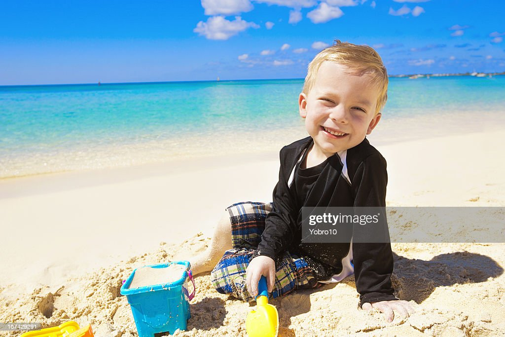Little Boy Playing in the Sand on Beach : Stock Photo