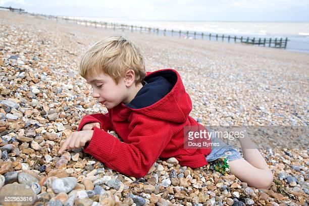 Little Boy Playing on a Rocky Beach