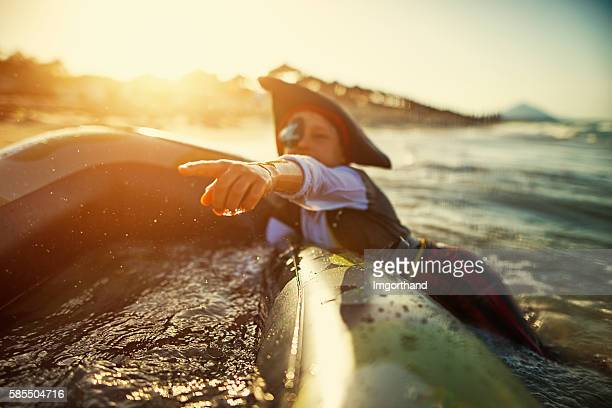 Little boy playing pirate on a sinking boat