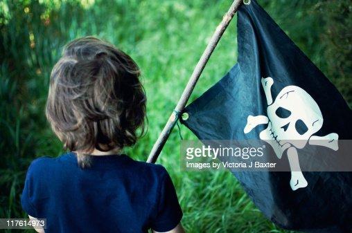 Little boy playing pirates : Stock Photo