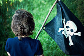 Little boy playing pirates