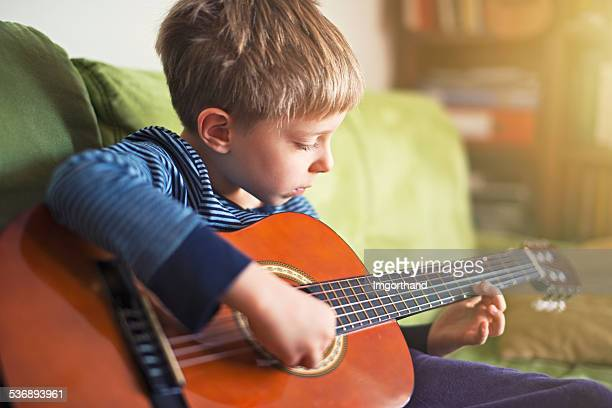 Little boy playing the guitar