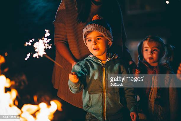 Little Boy Playing With a Sparkler