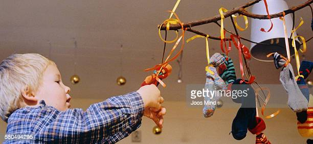 Little Boy Playing with Christmas Decorations on Mobile