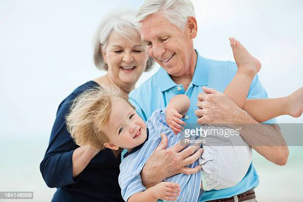 Little Boy Playing With Grandparents