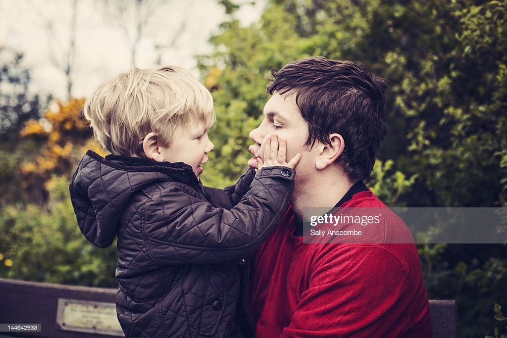 Little boy playing with his daddy : Stock Photo