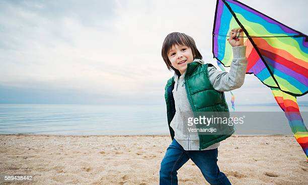 Little boy playing with kite