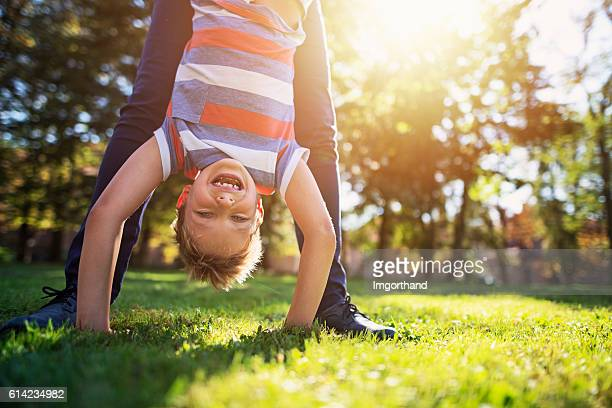 Little boy playing with mother in park