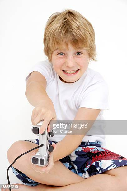 Boy (10-11) playing video game, portrait, close-up