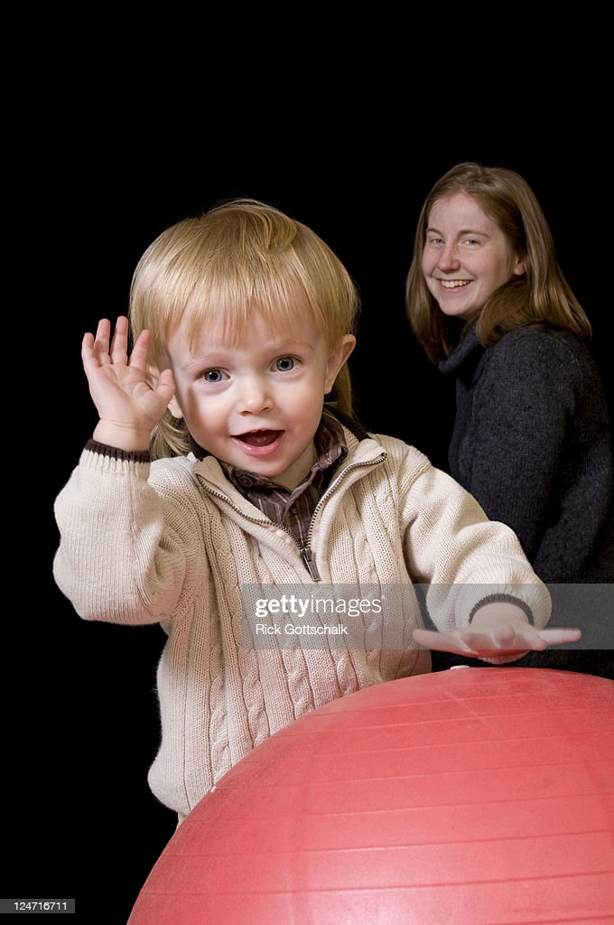 Little boy playing with red ball : Stock Photo
