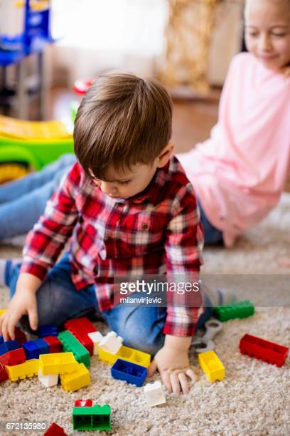 Little boy playing with toy blocks