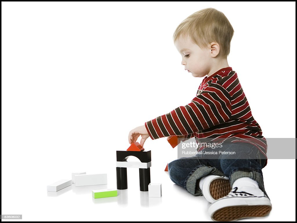 Little Boy Toys : Little boy playing with toys stock photo getty images