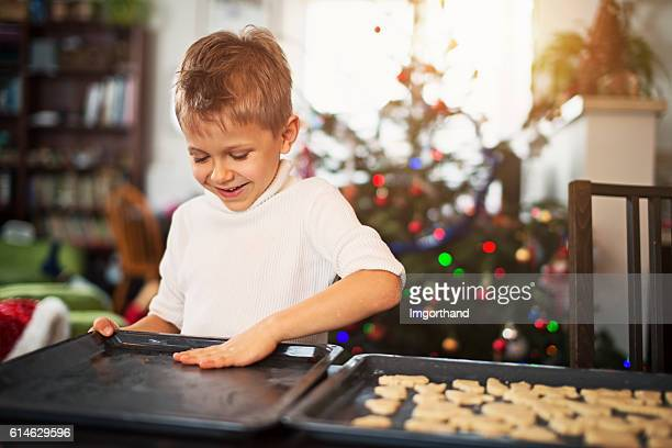 Little boy preparing christmas cookies