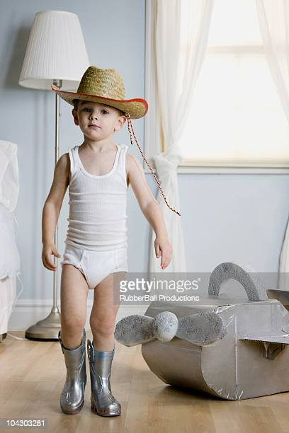 little boy pretending to be a cowboy