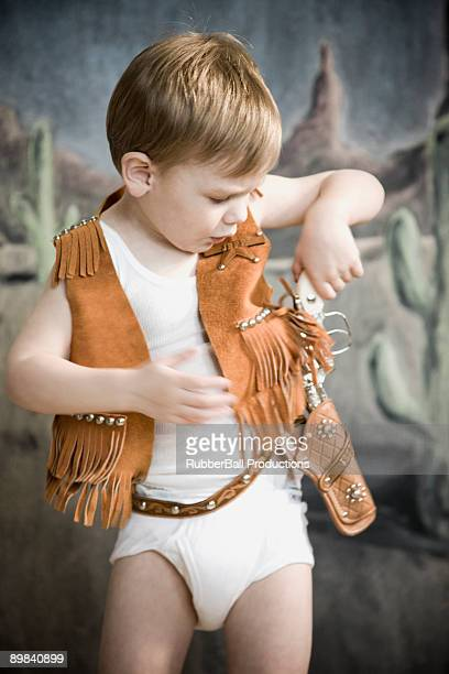 little boy pretending to be cowboy