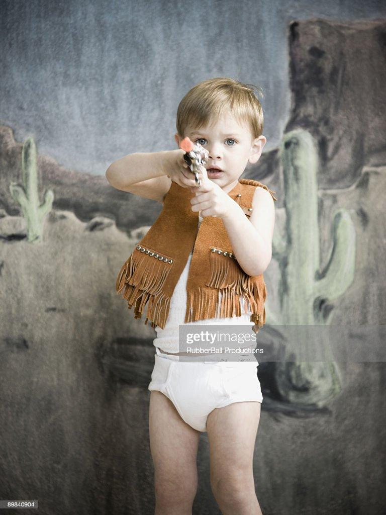 little boy pretending to be cowboy : Stock Photo