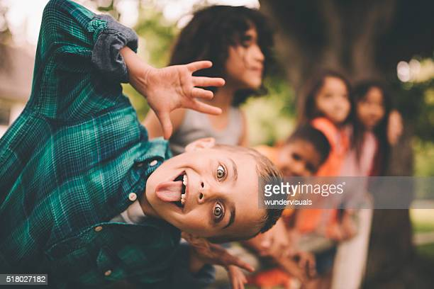 Little boy pulling a funny face with friends in background