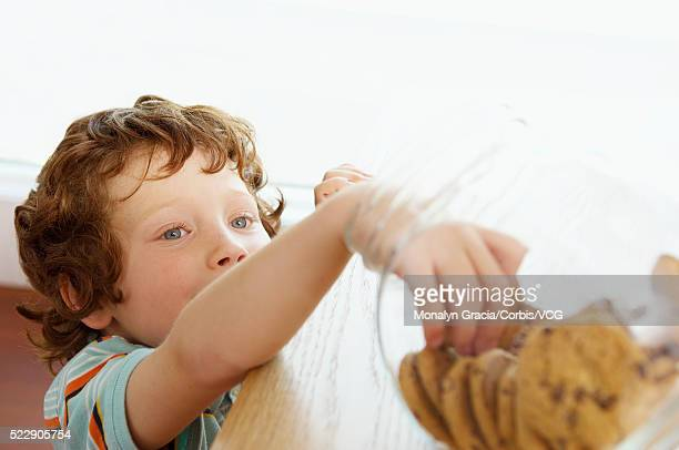 Little boy reaching for cookies